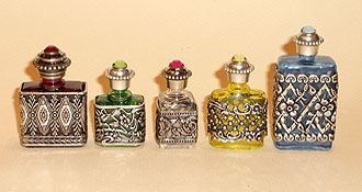 Perfume bottles and metal around